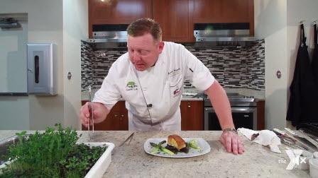 Chef prepares a Miso Chilean Sea Bass.